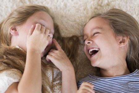 girls laughing on carpet