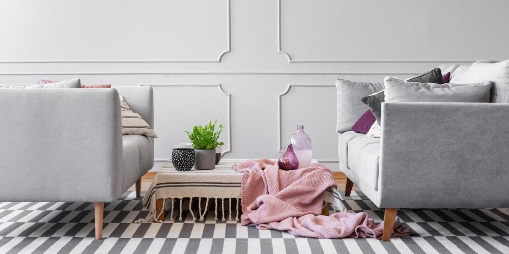 grey sofas on checked carpet