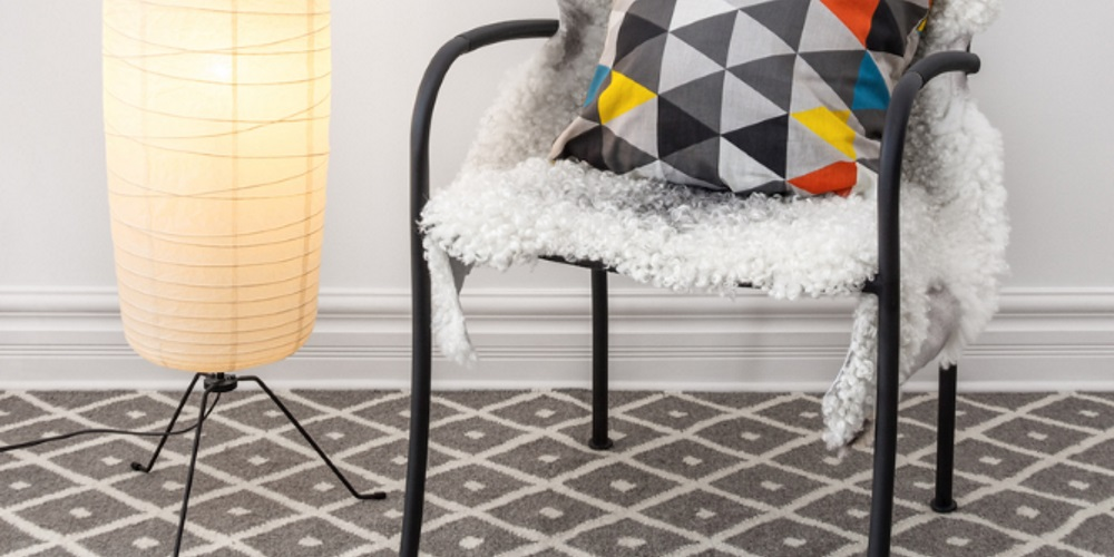 chair and lamp on carpet