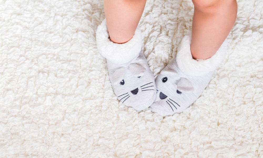 slipper socks on white carpet